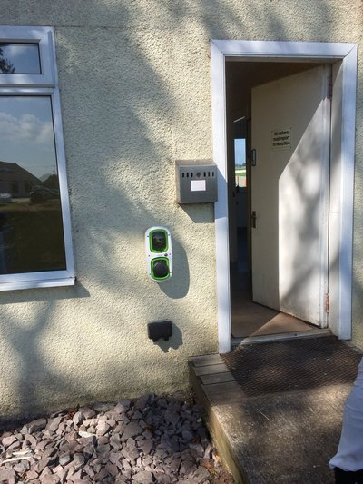 EV charge point outside door of Strathaven Airfield clubhouse